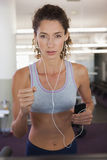 Fit focused woman running on the treadmill Royalty Free Stock Image