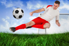 Fit football player playing and kicking ball Royalty Free Stock Photos