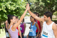 Fit friends before race in park Royalty Free Stock Photography