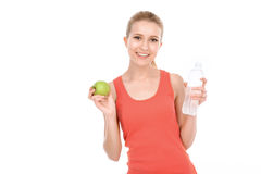 Fit girl with apple and water Stock Photography