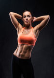 Fit girl. Beautiful fit girl with muscular body posing. Fitness concept stock images
