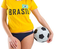 Fit girl in bikini and brasil tshirt holding ball Stock Image