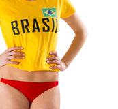 Fit girl in bikini and brasil tshirt Stock Photography