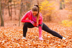 Fit girl doing stretching outdoor. Stock Photos