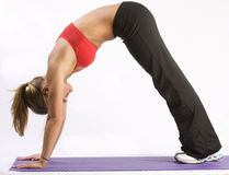 Fit girl doing yoga royalty free stock images