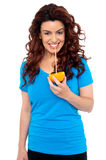 Fit girl drinking fresh orange juice Stock Photos