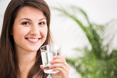 Fit girl drinking mineral water Royalty Free Stock Images