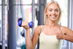 Fit girl with dumbbell Stock Photography
