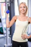 Fit girl with dumbbell Stock Photos
