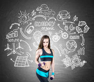 Fit girl with dumbbells and ecology icons Royalty Free Stock Photography