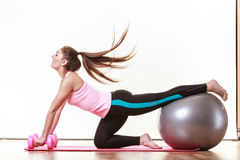 Fit girl exercising. Royalty Free Stock Photo