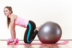 Fit girl exercising. Stock Photography