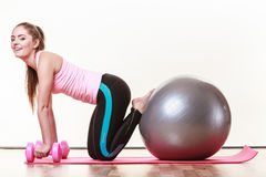 Fit girl exercising. Royalty Free Stock Photos