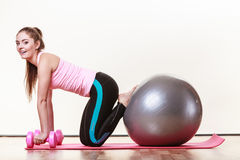 Fit girl exercising. Royalty Free Stock Image