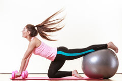 Fit girl exercising. Royalty Free Stock Photography