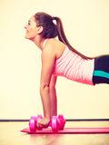 Fit girl exercising. Stock Photo