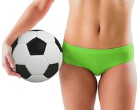 Fit girl in green bikini holding football Royalty Free Stock Images