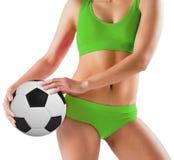 Fit girl in green bikini holding football Stock Photography