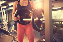 Fit girl in gym, concept Royalty Free Stock Image