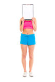 Fit girl holding blank clipboard in front of face Stock Photography