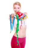Fit girl holding colorful measure tapes fruit Stock Photo
