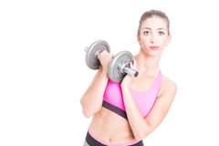 Fit girl holding heavy weight looking bored Royalty Free Stock Image