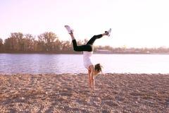 Fit girl at lake Stock Photography