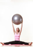 Fit girl lifting ball. Fitness health activity sport gym concept. Fit girl lifting ball. Young sporty lady exercising with training gear Royalty Free Stock Photos