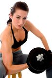 Fit girl lifting weights Royalty Free Stock Images