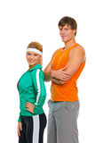 Fit girl and man in sports wear isolated on white Royalty Free Stock Image