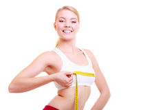 Fit girl with measure tape measuring her bust. Time for diet slimming weight loss. Health care and healthy nutrition. Young fitness woman fit girl with measure Royalty Free Stock Photo