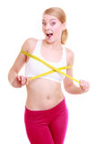 Fit girl with measure tape measuring her bust Royalty Free Stock Photo
