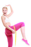Fit girl with measure tape measuring her thigh Royalty Free Stock Images