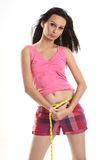 Fit girl measuring her waist with a measuring tape Stock Photography