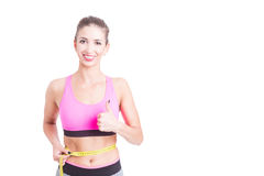 Fit girl measuring her waist and showing thumb up Royalty Free Stock Photos