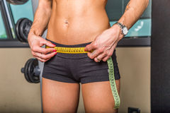 Woman measuring waist or hips Royalty Free Stock Image