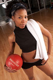 Fit girl posing in gym. A fit african american girl posing after a workout Stock Photos