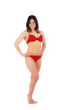 Fit girl in red bikini smiling Royalty Free Stock Image