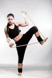 Fit girl with a rope Royalty Free Stock Images