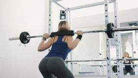Fit girl with sexy body doing barbell workout routine in gym, healthy lifestyle stock video footage