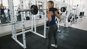 Fit girl with sexy body doing barbell workout routine in gym, healthy lifestyle stock footage