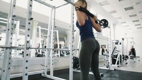 Fit girl with sexy body doing barbell workout routine in gym, healthy lifestyle stock video