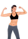 Fit girl showing her muscles Royalty Free Stock Images