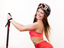 Fit girl with ski poles. Stock Photos