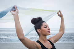 Fit girl standing with scarf blowing in wind Royalty Free Stock Photography