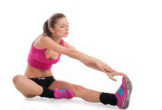 Fit girl stretching her leg Royalty Free Stock Image