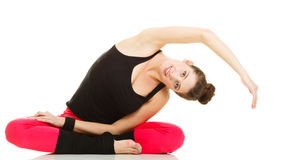 Fit girl stretching isolated on white. Stock Image