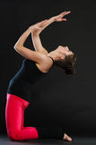 Fit girl stretching warming up. Royalty Free Stock Photography