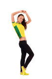 Fit girl training and stretching with her arms up. Royalty Free Stock Photos