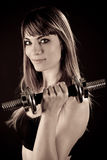 Fit girl working out with weights Royalty Free Stock Photography